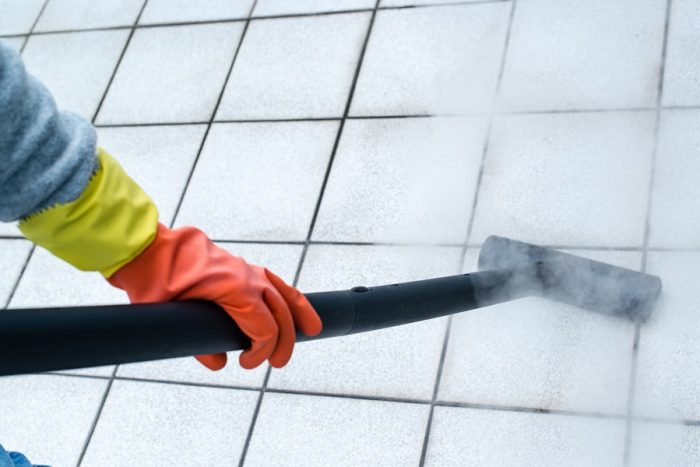 A steam cleaner being used on tiles